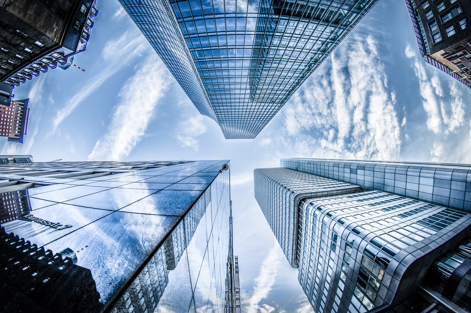 Look up at tall office buildings - Eric Everett Hawes Law Offices
